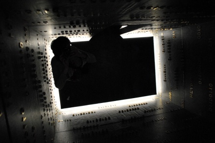 Me taking a photograph of the mirrored ceiling from below. Kinda like a mash-up of The Matrix and The Ring