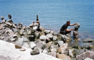 This environmental artist in San Francisco was pretty amazing. He'd spend ten minutes finding a perfect balancing point for a rock, and when he let go the rock miraculously remained standing.